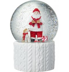 A charming white and red coloured snow globe featuring a Santa and Dog centre