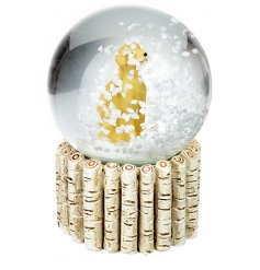 A sweet little sitting yellow dog in the centre of a glass snowglobe, give it a shake to watch the snow fall around it