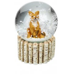 A charming little sitting fox in the centre of a glass snowglobe,