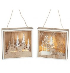 A beautiful assortment of natural toned wooden hanging plaques featuring cut out woodland scenes