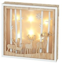 A beautifully decorated natural wooden plaque featuring a layered Forest Scene and warm glowing LED decal