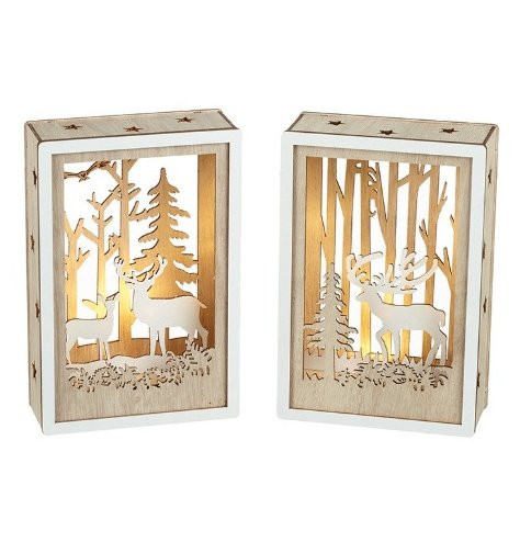 Natural wooden light boxes featuring layered woodland forrest scenes with reindeer and trees.