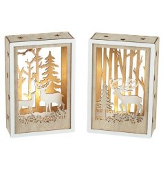 A beautiful assortment of natural toned wooden hanging plaques featuring cut out woodland scenes and warm glowing LEDs