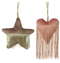 A grey and pink toned assortment of hanging velvet decorations featuring an added tassel trimming