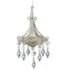 A gorgeously elegant hanging glass chandelier ornament featuring added acrylic droplets and glittery decals