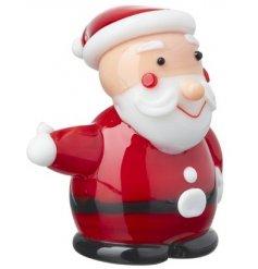 A mini glass figure in a cute Santa form,