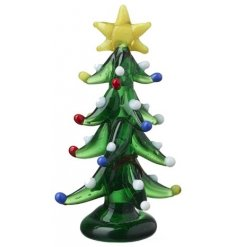 A mini glass figure in a festive tree form,