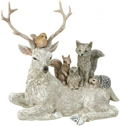An enchanting Christmas decoration featuring a stag surrounded by his woodland friends.