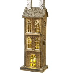 Bring a beautiful warm glow to your home interior at Christmas Time with this tall standing wooden house decoration