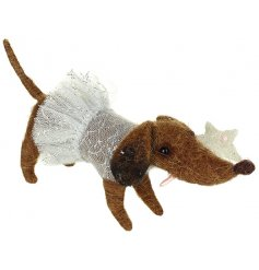 A cute little woollen sausage dog dressed up in a sparkly white tutu and holding a magical wand