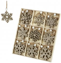 A large set of hanging wooden snowflakes in an array of styles and shapes.