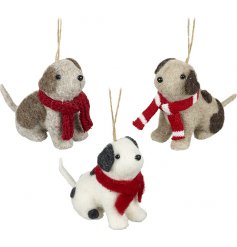 An assortment of three hanging felt dogs with festive scarves