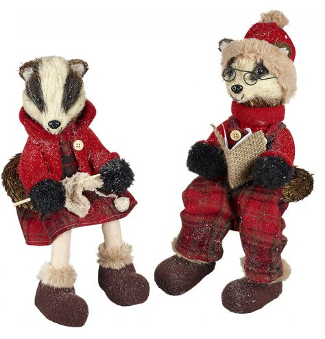 An assortment of 2 unique woodland badger decorations with traditional red and green tartan outfits