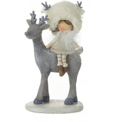An adorable reindeer decoration with a sweet girl sat on top. Complete with faux fur hat and feathers.