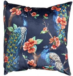 A beautifully decorated cushion in a navy blue tone