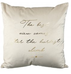 A beautifully golden scripted text printed on a plump ivory toned cushion