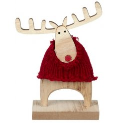A cute little natural wooden reindeer dressed up in a snuggly knitted jumper