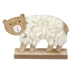 A natural toned wooden bear decoration coated in a a soft white wool