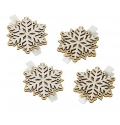 Hang up your Christmas cards with these charming little wooden clips featuring snowflake patterns
