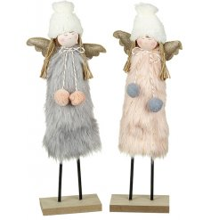 An assortment of wooden standing angels, complete with fuzzy grey and pink toned decals