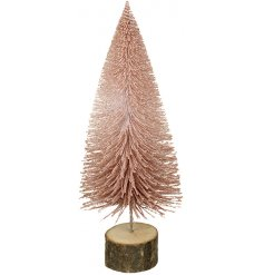 A sparkly pink bristle tree on a wooden bark base