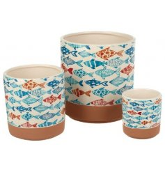 An assorted set of sized planters each featuring a quirky blue and orange toned fish pattern