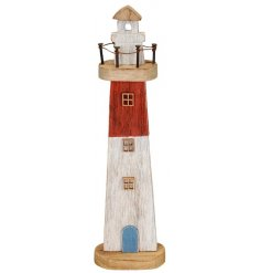 A charming Red and White toned wooden light house ornament decorated with additional distressed settings and features
