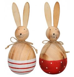A delightful assortment of smooth wooden egg shaped bunnies with red tones and patterns
