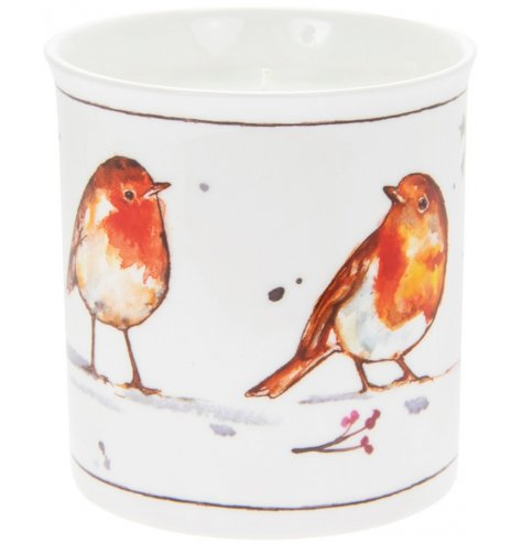 A lovely winter robin illustration on the side of a ceramic pot with a candle set within.