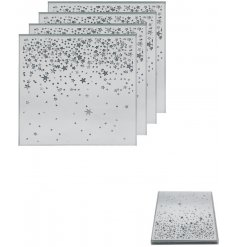 Decorated with sparkly falling stars, this beautiful set of mirrored coasters will be sure to place perfectly