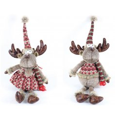 An assortment of festive sitting reindeer decorations dressed up in a Nordic themed dress and jumper