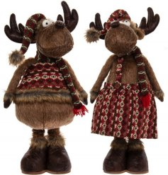 An assortment of festive standing reindeer decorations dressed up in a Nordic themed dress and jumper
