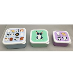 A set of three funky dog squad themed lunch boxes.
