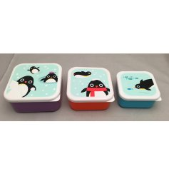 A set of three funky penguin squad themed stacking lunch boxes.