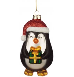 A cute and festive little hanging glass penguin ornament, perfect for bringing to any tree display at Christmas