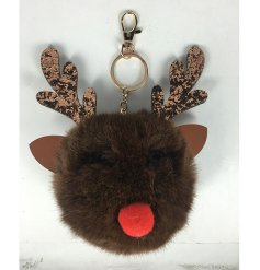 A cute and fuzzy pompom keyring in a Reindeer form