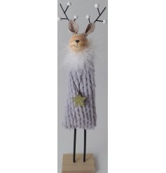 A charming little wooden reindeer decoration dressed up a soft faux fur grey coat