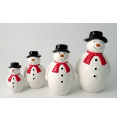 A cute little sitting ceramic snowman complete with a traditional hat and scarf decal