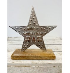 A chic and unique standing star shaped sign reading Merry Christmas. A rustic gift item with a hammered silver finish
