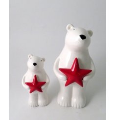 A cute little standing polar bear decoration complete with a festive red toned star