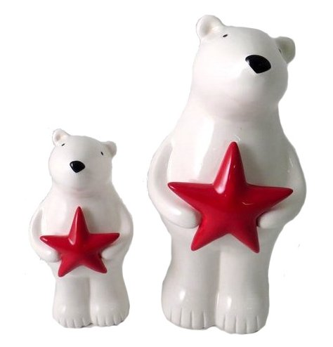 An adorable standing polar bear decoration with a cute painted face and red star charm.