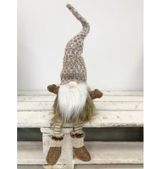 A cute woodland style gonk with knitted and faux fur details. A charming decoration for the home this season.