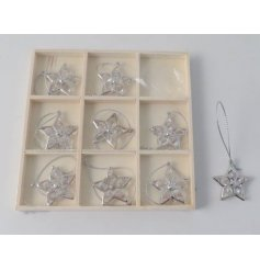 A charming set of mini silver star decorations
