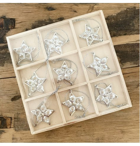 A set of 9 miniature silver star hangers with clear gemstone detailing. Complete with silver string hangers