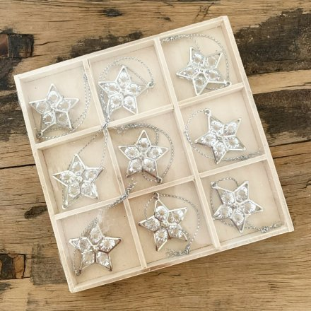 A simple set of 9 mini hanging silver star decorations