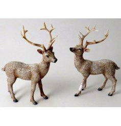this standing resin reindeer ornament will be sure to place perfectly in any home space during Christmas time