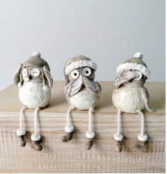 A cute mix of sitting resin owl decorations with dangly legs
