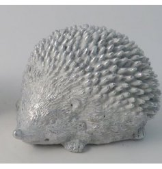 A small resin Hedgehog in a silver tone and coated with a subtle sprinkle of glitter