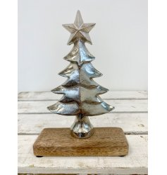 A chic aluminium silver tree with star. A gorgeous seasonal gift and interior accessory.