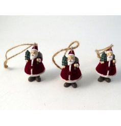 A festive little hanging Santa figure complete with a red velvet coat
